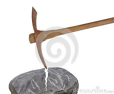 Old pick axe breaking rock isolated.