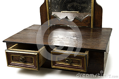 Old Piece of Furniture with Drawers and Mirror Stock Photo