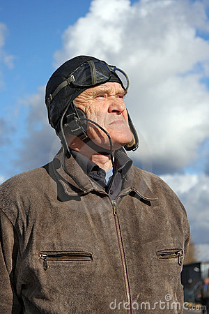 Old pilot looking to the sky