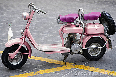 Old and pink motorbike