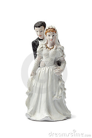 Old plaster bride and groom cake topper