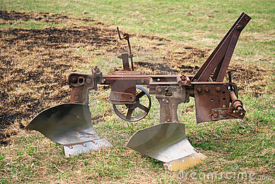 Old plow for tractor Stock Photo