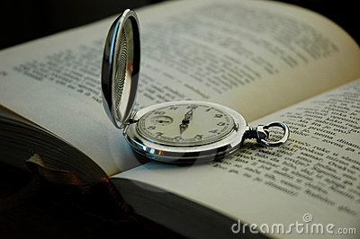Old pocket watch and book