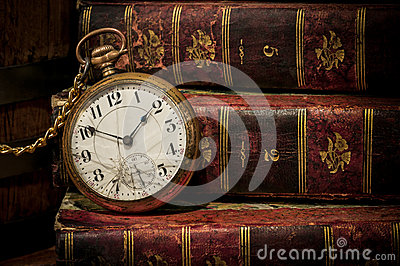 Old pocket watch and books in Low-key copy space