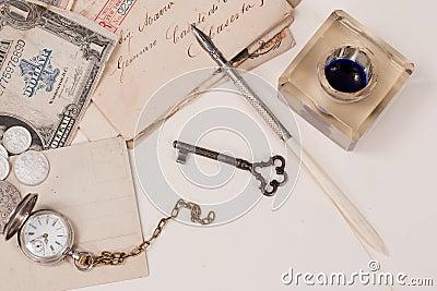 old pocket watch, old ink pen, handwrite letters