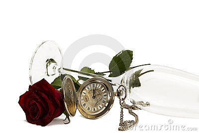 Old pocket watch with a red wet rose under a lying