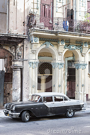 Old Pontiac next to crumbling buildings in Havana Editorial Photography