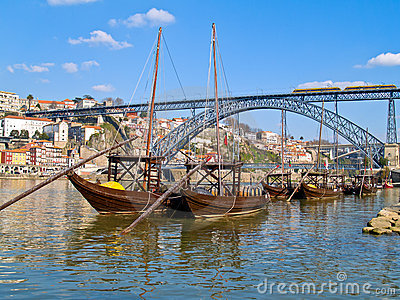 Old Porto and  traditional boats with wine barrels