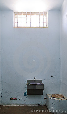 Old prison cell with barred window