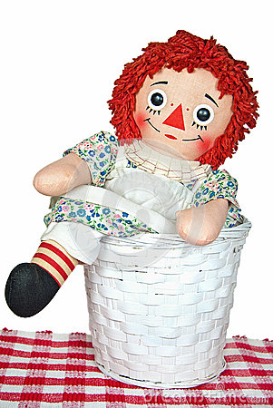 Old rag doll in basket