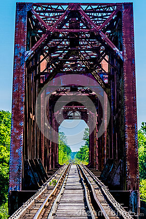 Free Old Railroad Trestle With An Old Iconic Iron Truss Bridge Royalty Free Stock Images - 48264169