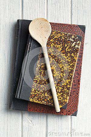 Old recipe book on wooden table