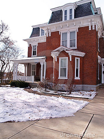 Old red brick house in winter