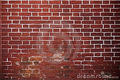 Old red brick wall background.