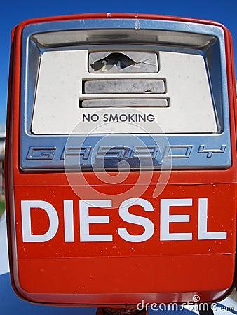 Old red farming diesel fuel pump straight shot