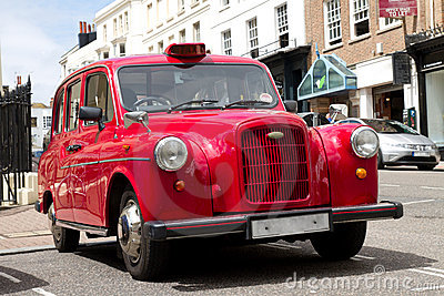 Old red taxi in London
