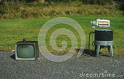 Old retro television and washing machine,