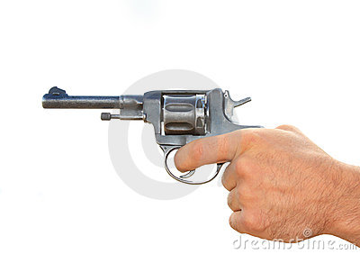 Old revolver in a hand isolated
