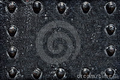 Old Rivets on Black Metal Plate Grunge Background