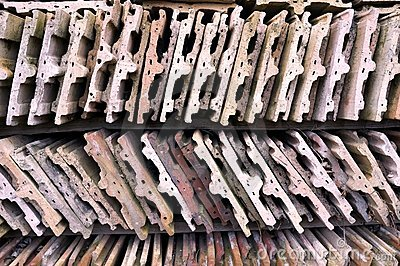 Old roofing tiles stored on wooden shelves