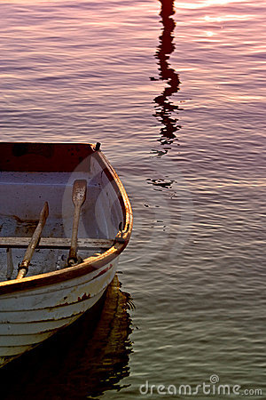 Free Old Rowing Boat With Oars On Sea During Sunset Stock Photos - 573043