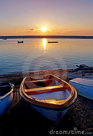 Old Rowing Boats by Sea During Sunset