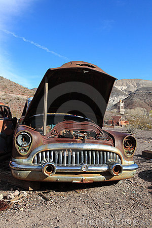 Old rusted car in junk yard