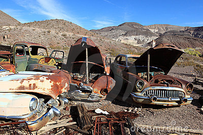 Old rusted cars in junk yard