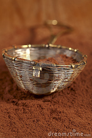 Old rustic style silver sieve with cocoa powder