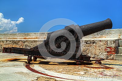 Old rusty cannon on a castle