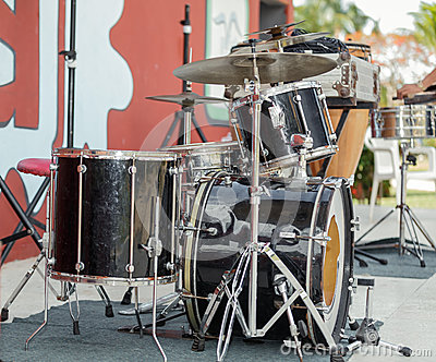 Old rusty dirty drum kit on outdoor concert stage