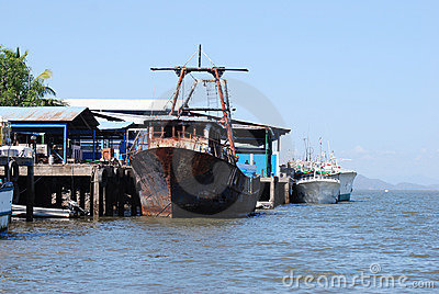 Old rusty Fishing vessel in port docked