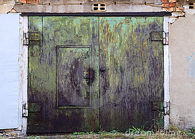 Old rusty garage doors closed