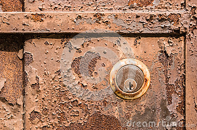Old rusty metal plate and lock
