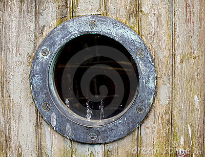 An old rusty ship port hole