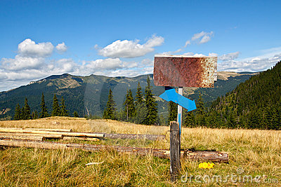 Old rusty sign in the mountains