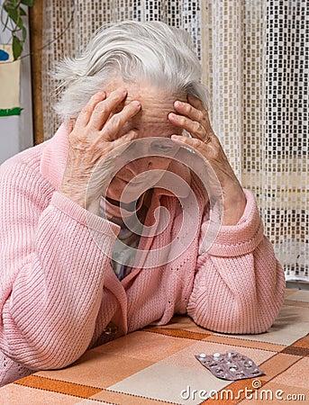 Free Old Sad Woman Holding Pills Stock Photo - 48890980