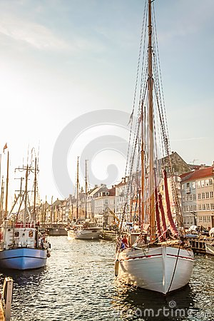 Old sailing boat in evening light in Copenhagen Editorial Stock Image