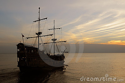 Old sailing ship at dusk