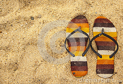 Old sandal on the sand