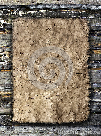 Old sheet of parchment on a grungy wooden background