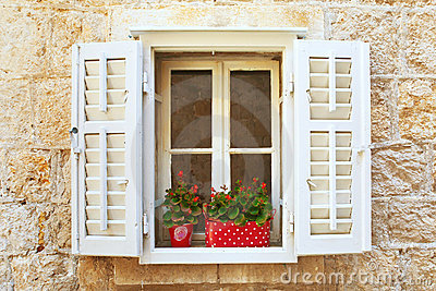Old Shutter windows with a flowers. Croatia.