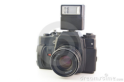 Old SLR camera with flash