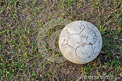 Old Soccer Ball. Poor school soccer field.