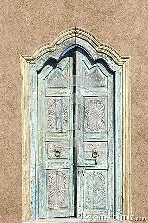 Old Spanish style Door thru an adobe garden wall