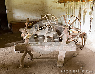 Old spinning wheels in spanish mission