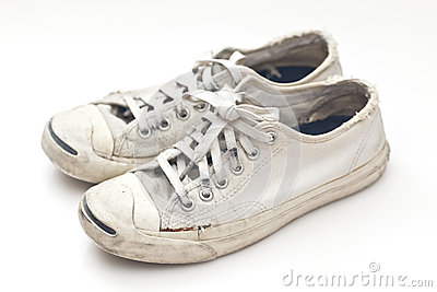 Old sport shoes on white background