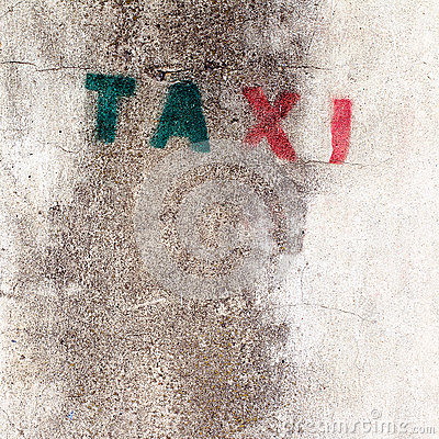 Old stencil taxi sign on the wall