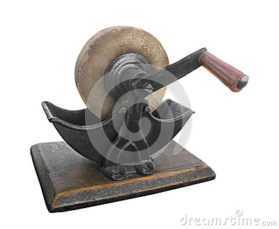 Old stone sharpening grinding wheel isolated.