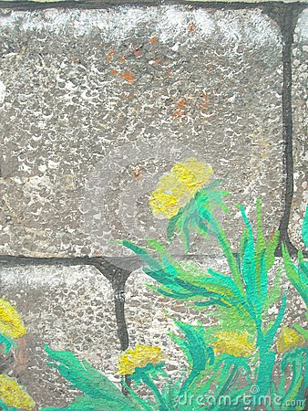 Old stone wall overgrown with painted flowers